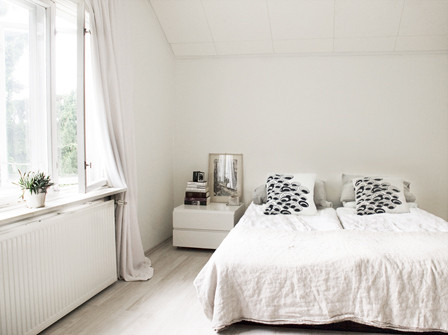A light, comfortable bedroom with natural linen textiles - linen bedding and curtains
