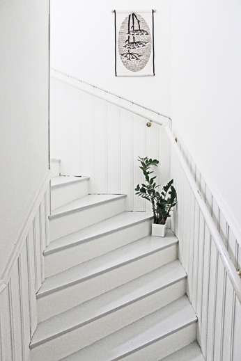 This staircase is kept clear and simple with an elegant and charming poster